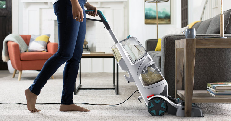 A carpet cleaner removes spills and stains