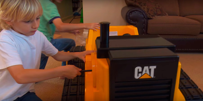 Kid Trax Cat KT1136 Ride On Bulldozer in the use