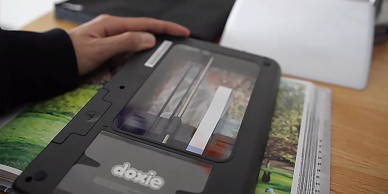 Doxie Flip Cordless Flatbed Scanner in the use