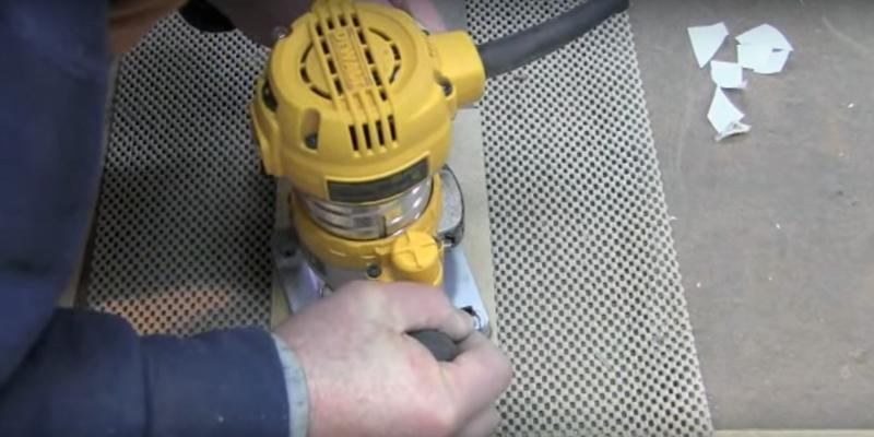 DEWALT DWP611PK Variable Speed Compact Router Combo Kit with LED's in the use