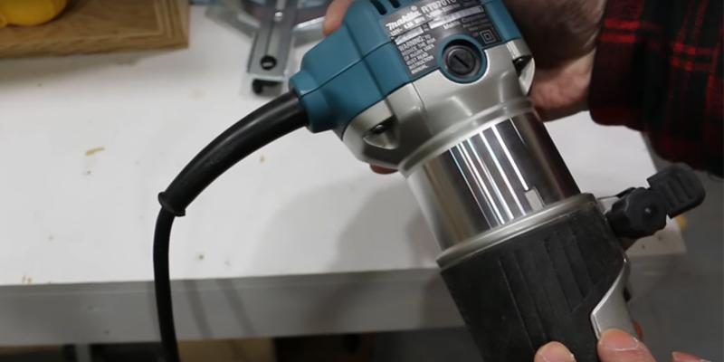 Makita RT0701C Compact Router in the use
