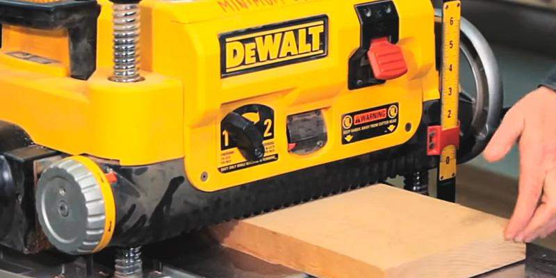 DEWALT DW735X Two Speed Thickness Planer Package in the use