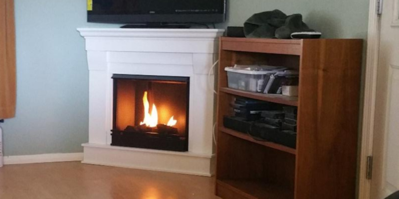 Real Flame 5950-W Chateau Corner Gel Fireplace in White in the use