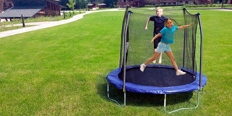 Skywalker Trampolines Jump N' Dunk Trampoline with Safety Enclosure and Basketball Hoop in the use