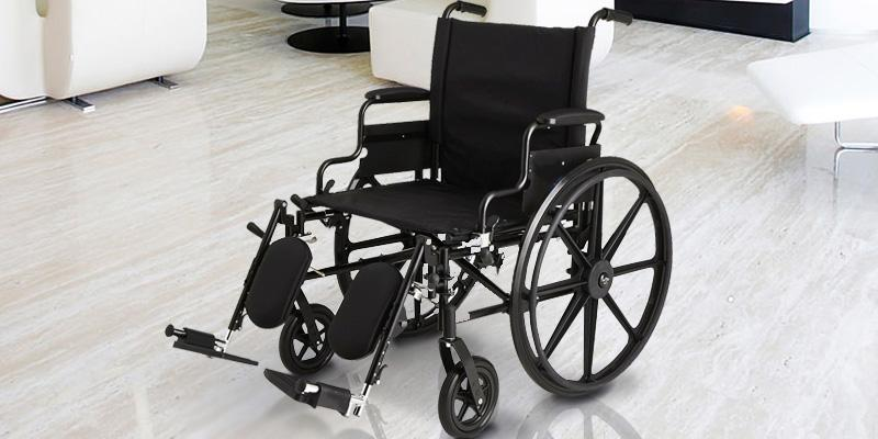 Medline MDS806575 K4 Extra-Wide Lightweight Elevating Wheelchair in the use