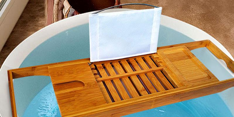 Bathique Bamboo Bathtub Caddy with Rubber Grip in the use