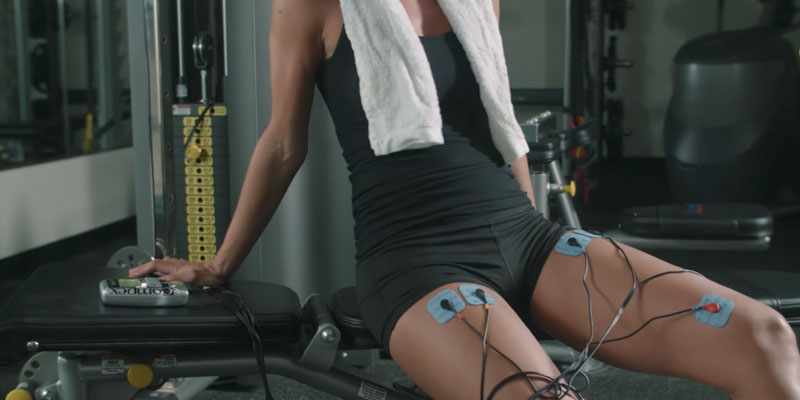 Compex Edge Electronic Muscle Stimulator Kit in the use
